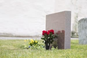 Headstone with flowers.